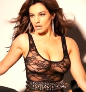 Kelly Brook shows nipples in see-through lace top sitting astride motorbike