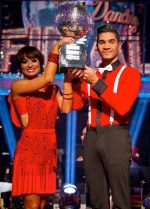 Louis Smith and Flavia Cacae lift the Strictly Come Dancing glitterball trophy for 2012