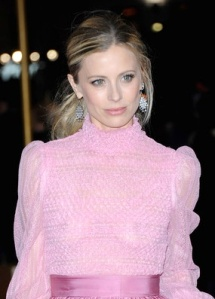 Model Laura Bailey shows nipples under see-through pink top.