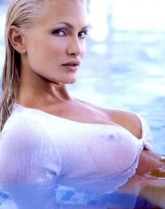 Caprice in pool with wet shirt showing nipples