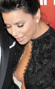 Eva Longoria wardrobe malfunction shows right breast and nipple popping out of dress at Golden Globes