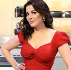 Nigella Lawson in low-cut scarlet Billion Dollar Baby dress on The Taste.