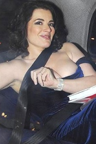 Nigella Lawson wardrobe malfunction - shows boobs in back of taxi