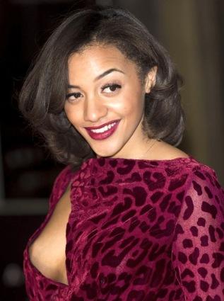 Amal Fashanu - nip slip - wardrobe malfunction in red leopard print dress at movie premiere