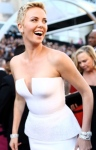 Charlize Theron in low cut Christian Dior dress at 2013 Oscars