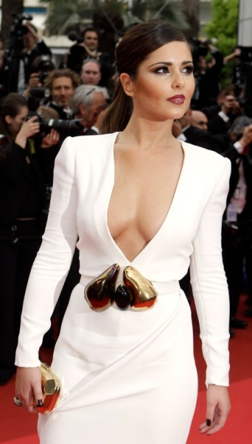 Cheryl Cole in low-cut white dress showing boobs