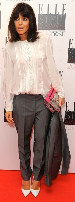 Claudia Winkleman in man's style suit with see-through blouse at Elle Style Awards