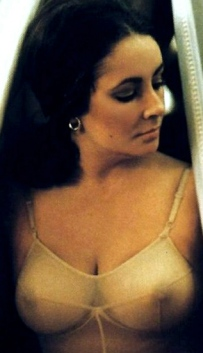 Elizabeth Taylor shows nipples in see-through bra in scene from 1974 movie The Driver's Seat