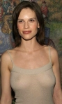 Hilary Swank - breasts and nipples showing in seethrough top.