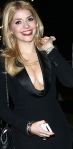 Holly Willoughby in very low cut satin dress showing lots of cleavage at 2013 BAFTAs