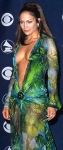Jennifer Lopez in green see-through dress showing bare boobs at Grammys 2000