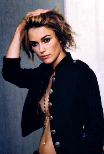 Keira Knightley shows boob in open jacket
