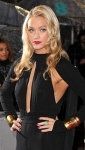 Laura Whitmore reveals sideboob and shows nipples in black jumpsuit at BAFTA Awards 2013.