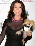 Lisa Vanderpump - Real Housewives of Beverly Hills star in a cleavage baring dress and her hairy little friend Giggy the dog