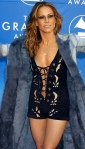 Sheryl Crow in short black dress with low cut and laced top showing breasts at 2002 Grammys