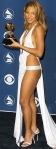 Toni Braxton in barely there Richard Tyler dress showing sideboob and all her long legs at 2001 Grammys