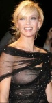 Uma Thurman in see through top. Blonde actress shows nipples through top.