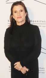 55-year old Carrie Fisher in see-through black dress showing bra