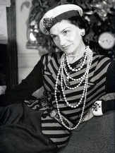 Coco Chanel with hat and jewellery