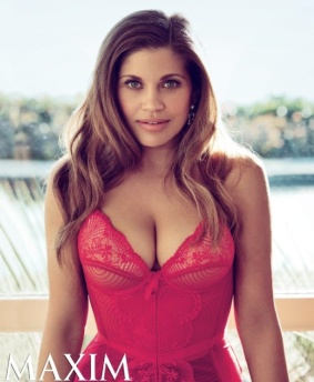 Danielle Fishel looks hot showing cleavage in red bustier corset. Topanga from Boy Meets World. Photo from Maxim.