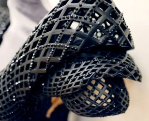 Detail of Schmidt and Bitonti's 3D printed dress with Swarovski crystals