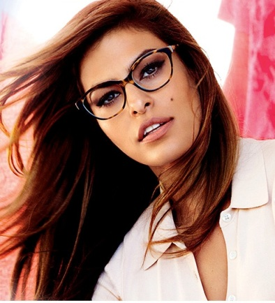 Eva Mendes rocks the sexy secretary look in Vogue glasses. Photo by Mario Testino