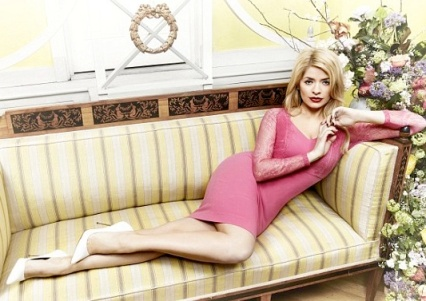 Holly Willoughby lying back on chaise longue in pink dress