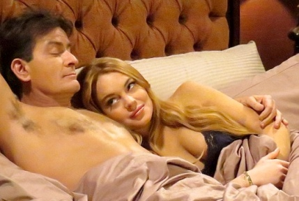 Lidsay Lohan showing cleavage in lacy black bra in bed with Charlie Sheen - Anger Management 2013
