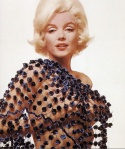 Marilyn Monroe cups breasts in hands in nude photo from Last Session. Bert Stern