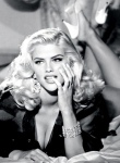 Anna Nicole Smith chanelling Jane Russell in Guess ad campaign. Big cleavage shot.