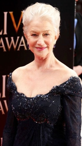 Helen Mirren in low cut black dress at Olivier Awards