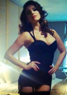 Kelly Brook channels Sophia Loren in black basque and stockings