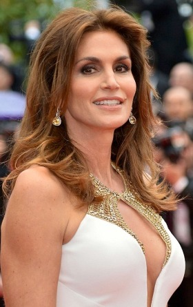 47-year old Cindy Crawford shows off cleavage in white and gold Roberto Cavali gown at Cannes Film Festival
