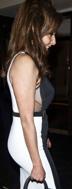 Carol Vorderman shows breasts in sideboob revealing Stella McCartney dress