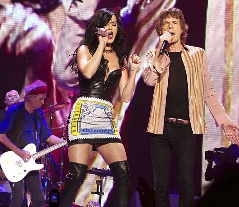 Katy Perry in leather bustier and thigh high leather boots on stage with the Rolling Stones