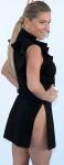 Ke$ha shows nude rear in split dress