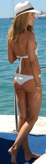 Kimberley Garner shows pert bottom in white swimsuit