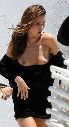 MIranda Kerr wardrobe malfunction exposes both breasts. Oops!