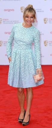 Sienna Miller wins style award at 2013 TV BAFTAs