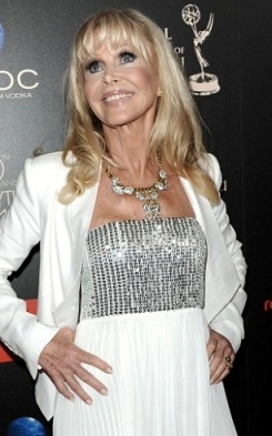70-year old Britt Ekland in low cut sequin top at Emmy Awards