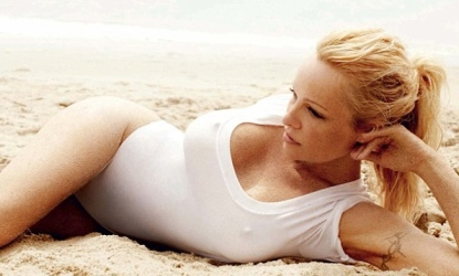Baywatch star Pamela Anderson in see-through white bathing suit on the beach
