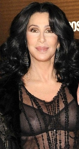 Cher shows nipples and breasts in see-through black top