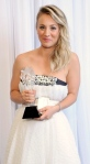 Kaley Cuoco from Big Bang Theory wearing white gown to pick up Critics Choice TV Award