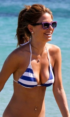Maria Menounos shows cleavage in tiny Greek bikini