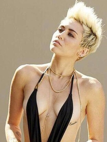 Miley Cyrus bare boobs under little monokini straps