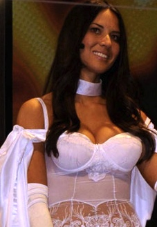 Olivia Munn shows cleavage in white lingerie style bustier. Autobiography Suck It Wonder Woman!