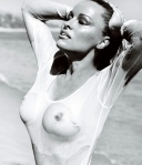 Pamela Anderson shows boobs and nipples in wet see-through bathing suit. Vogue Brazil, Mario Testino.