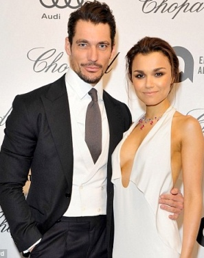 Samantha Barks in cleavage showing plunge front gown and boyfriend David Gandy. Les Miserables actress and male model. Elton John White Tie and Tiara Ball