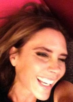 Victoria Beckham laughing. Photo of VB, Posh Spice smiling for her husband David Beckham.