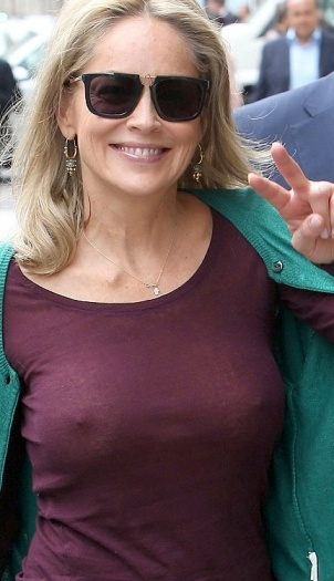 55-year old Sharon Stone shows breasts and hard nipples in see-through top.